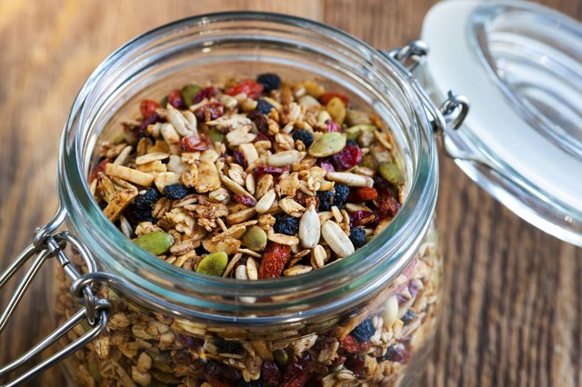 Homemade granola in open glass jar