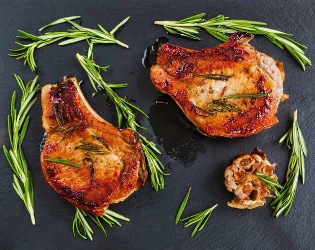 Roasted pork steaks, fresh rosemary and garlic