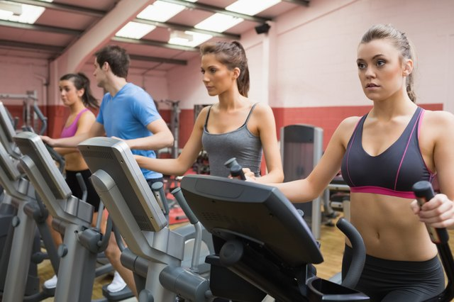Four people on step machines