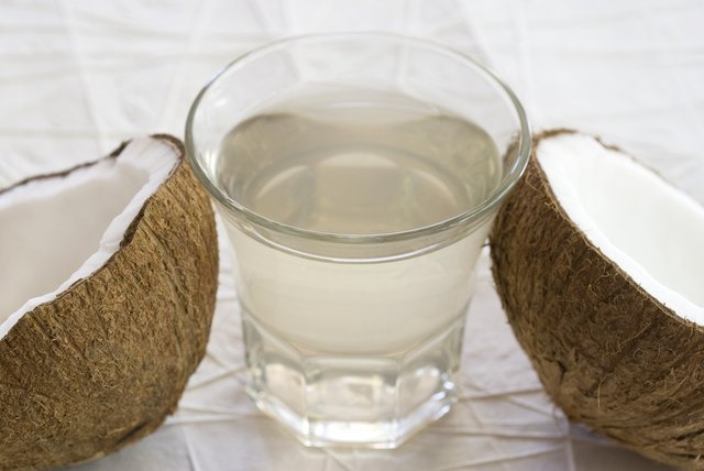 coconut water with coconut halves