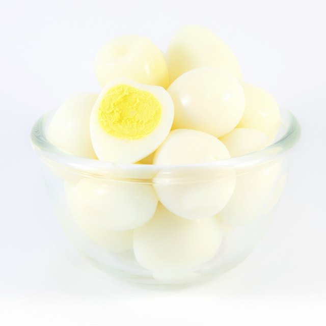 Boiled quail eggs on white background