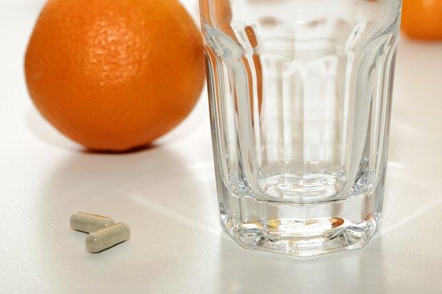Vitamin C pills and Oranges