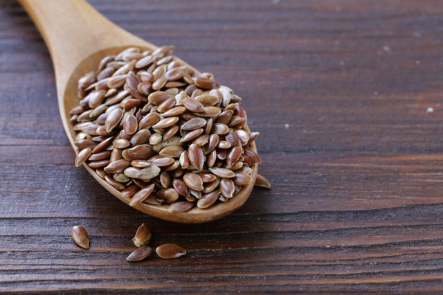 Flax seed in a wooden spoon on the table