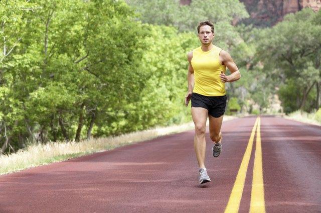 Runner man running on road