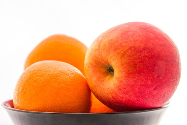 Apple with orange in the bowl.