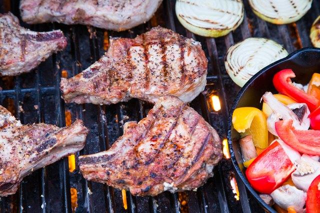 Grilled pork chops on BBQ