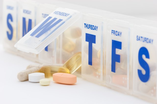 Daily vitamin and supplement pills with organizer