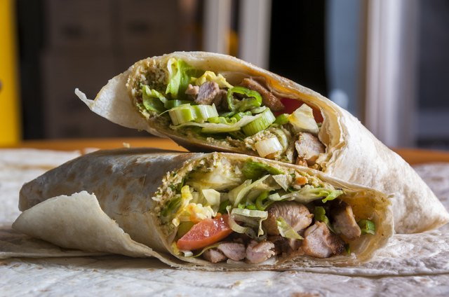 Cut indian wrap with chicken meat and garam masala