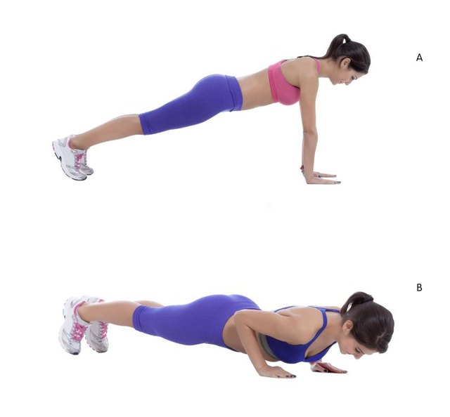 Come into plank position with your arms and legs straight, shoulders above the wrists. (A) Take a breath in and as you exhale, bend your elbows out to the sides and lower your chest toward the ground. Stop as soon as your shoulders are in line with your elbows. (B)