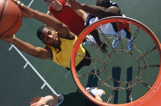 high angle view of a basketball player slam dunking a basketball