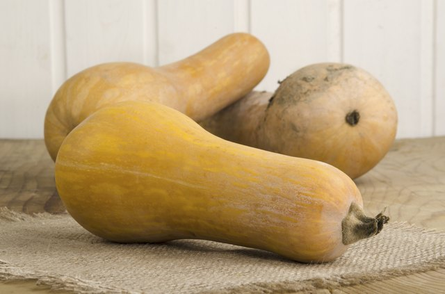 butternut pumpkins lying on a kitchen table