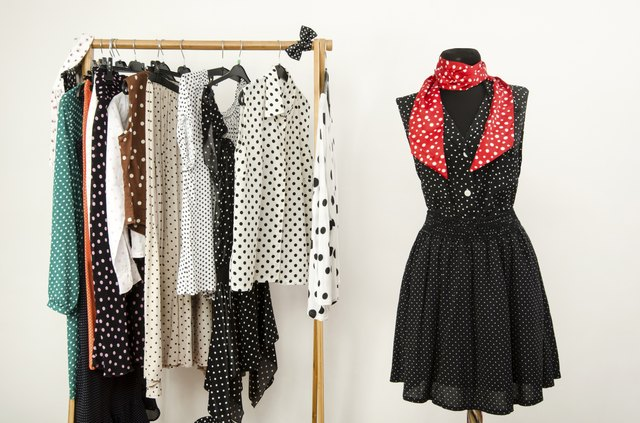 Colorful wardrobe with polka dots clothes and accessories.