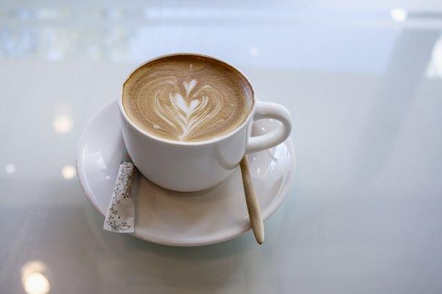 cup of hot latte art heart shape for morning