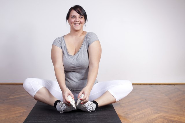 Happy overweight woman stretching