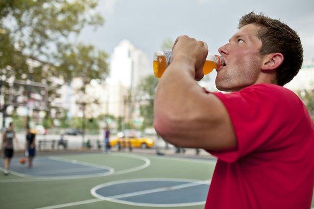 Man having sports drink court