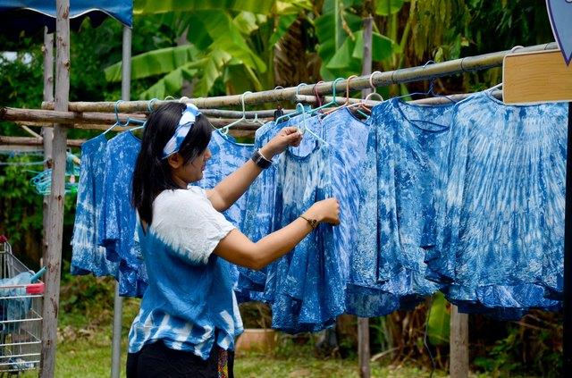 People working Batik dye Mauhom color