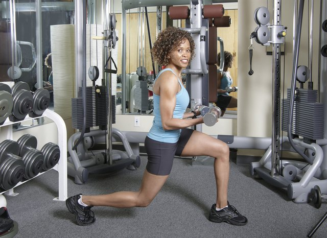 Woman doing lunges and curls