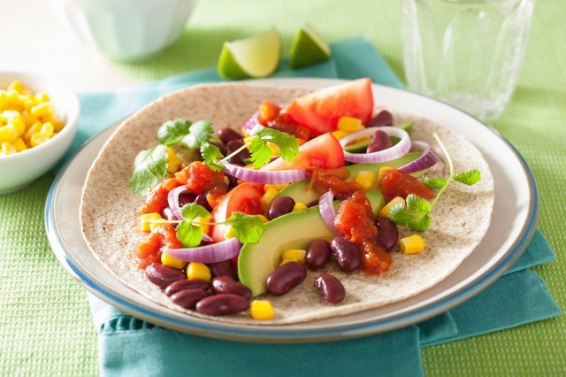 vegan taco with vegetable, kidey beans and salsa