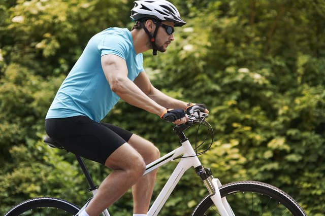 Handsome man during the training on his bike