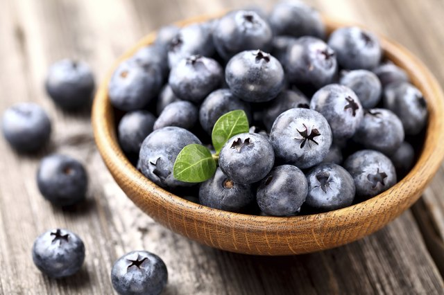 Blueberry in a wooden plate