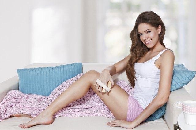 Beautiful woman doing skin care at home