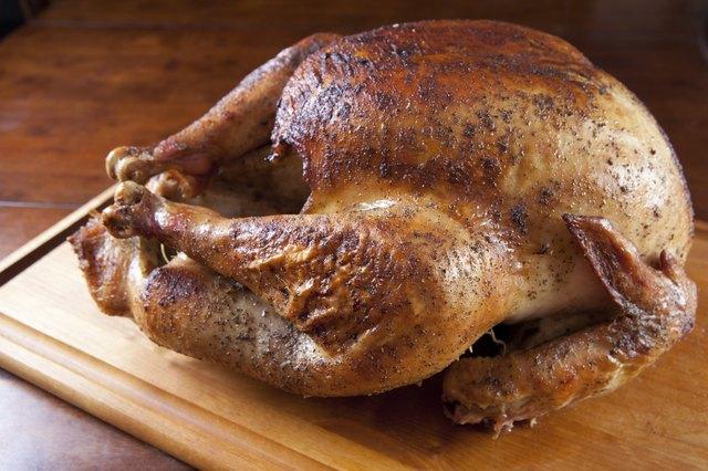 Roasted Turkey Resting on Wooden Board