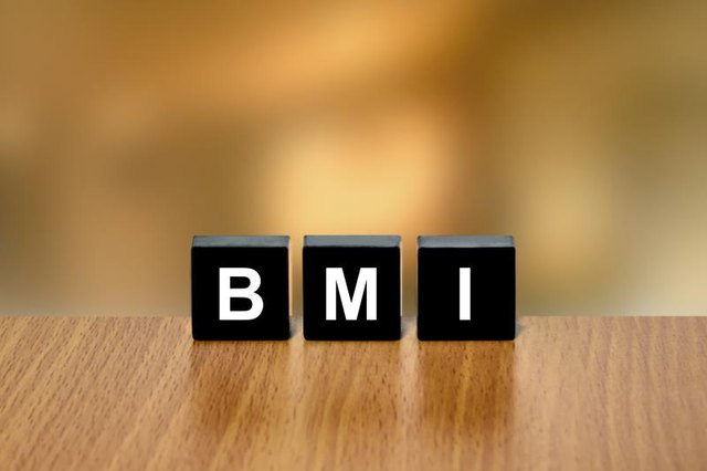 BMI or Body Mass Index on black block with blurred background