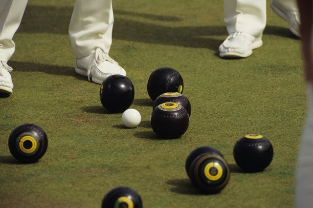 Two men lawn bowling, Victoria Commonwealth Games, low section