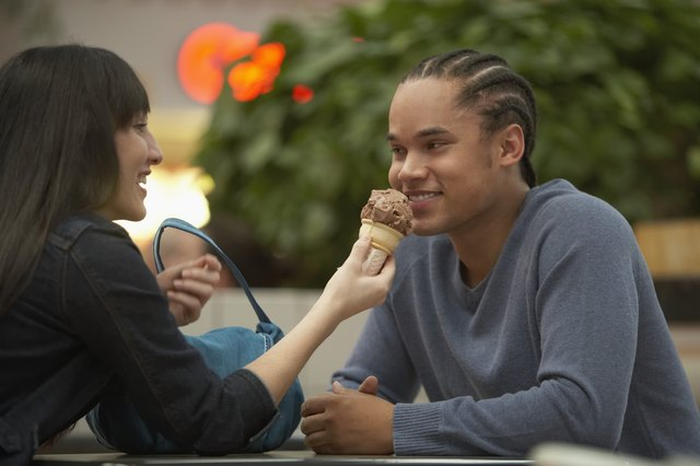 Teenage couple sitting at a table