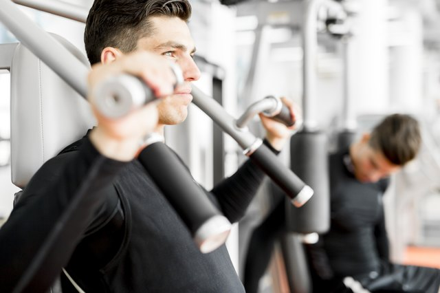 Young handsome man working out in a  gym