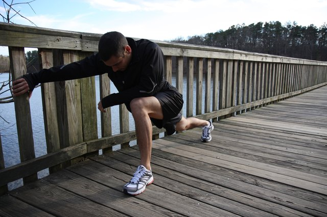 Athletic Male Runner Stretching