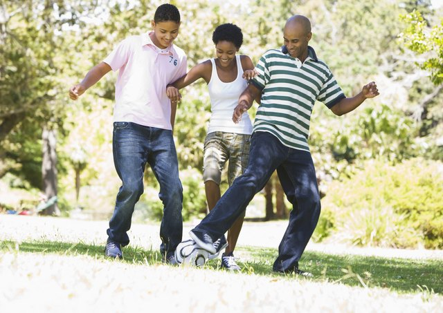 Family kicking ball