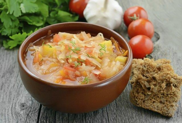 Sauerkraut soup in brown bowl