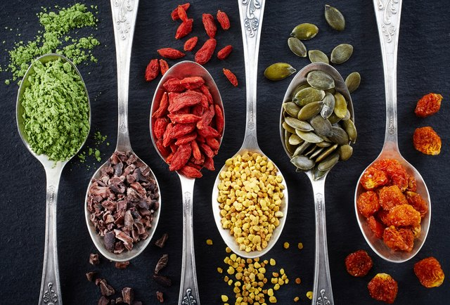 Superfoods in separate spoons laid next to each other