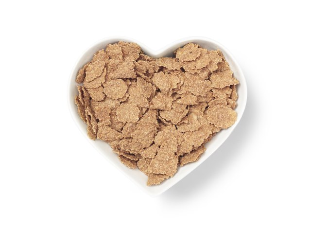 heart shaped bowl bran cereal - Stock Image
