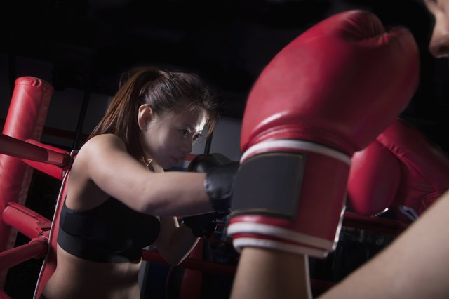 Over the shoulder view of two female boxers boxing in the boxing ring in Beijing, China