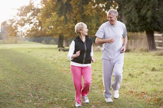 Senior Couple Power Walking In The Park