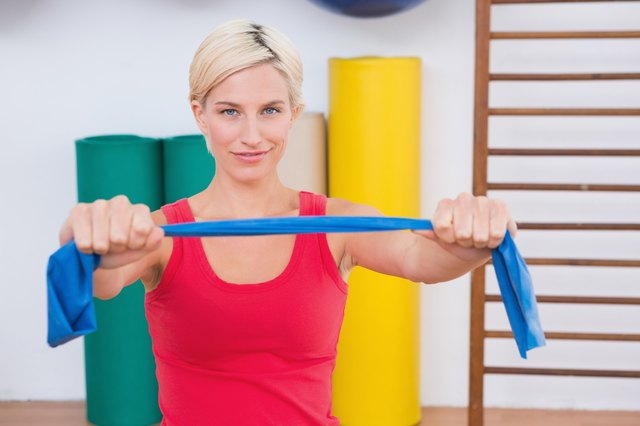 Blonde woman stretching arms