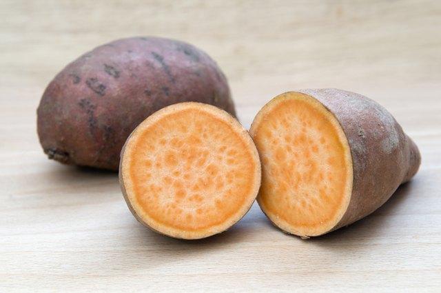 Sweet potatoes on chopping board