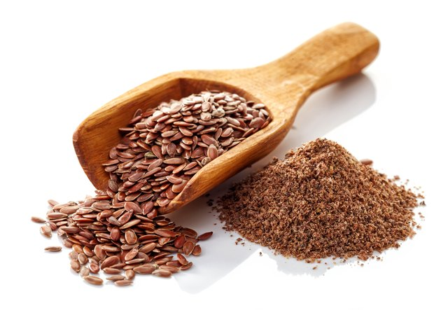 Flax seeds on a white background