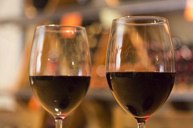 Line of two wine glasses full of wine