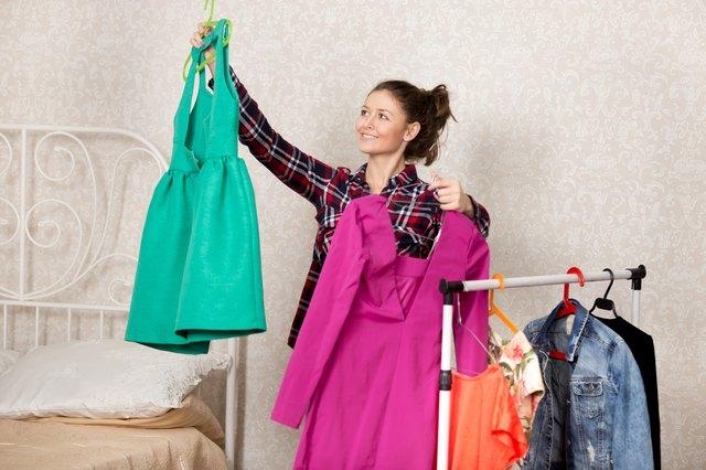 Girl chooses dresses