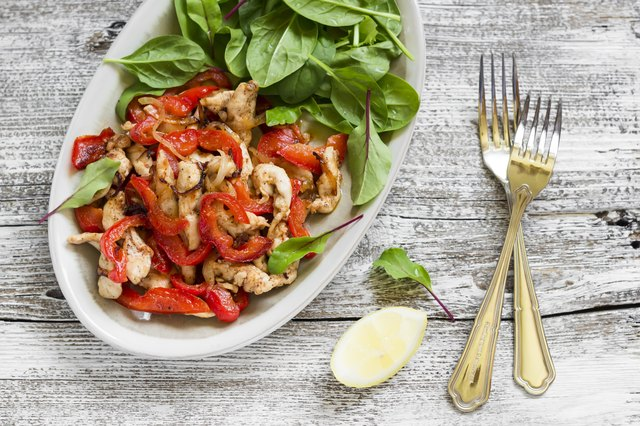 stir fry of chicken breast and pepper and fresh spinach