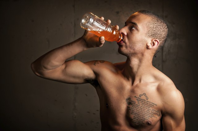 Black male drinking a sports drink