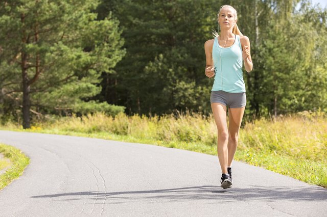 Young woman runs outdoor in the forest