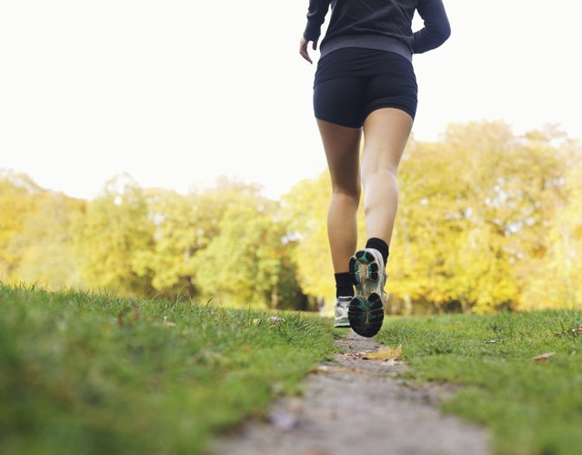 Rear view of woman athlete jogging in park
