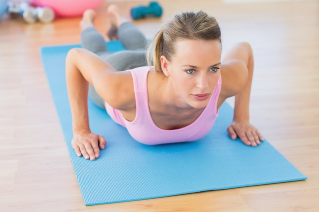 Determined beautiful woman doing push ups