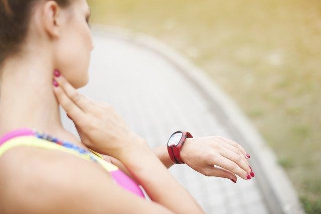 Woman examining her pulse parometer