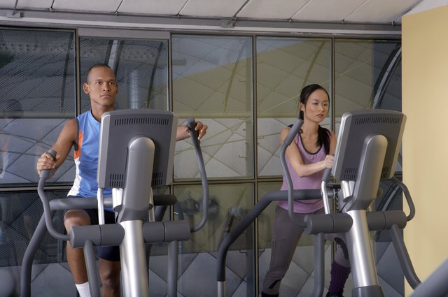 Man and woman working out in the gym.