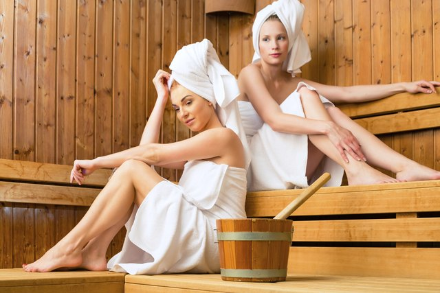 women in wellness spa enjoying sauna infusion